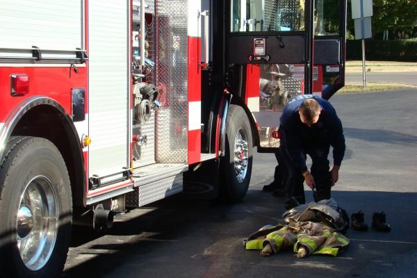 Fireman putting on gear - Bowling Green Fire Department