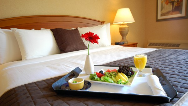 Breakast on a hotel bed