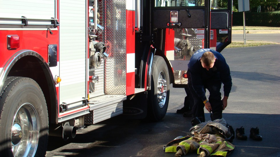 Fireman putting on gear - Bowling Green Fire Department