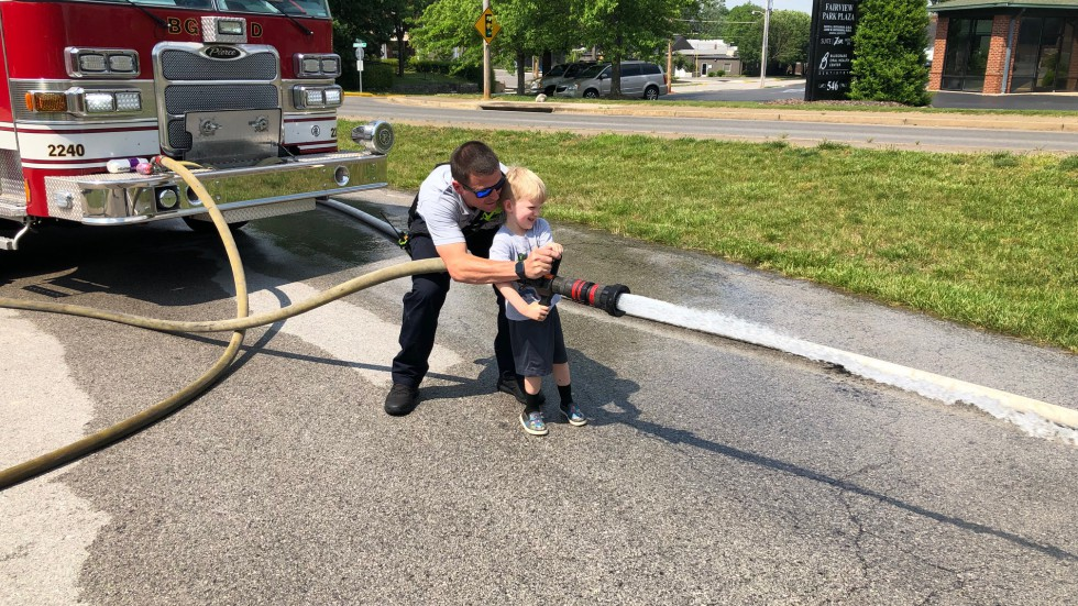Child Spraying Fire Hose - Bowling Green Fire Department